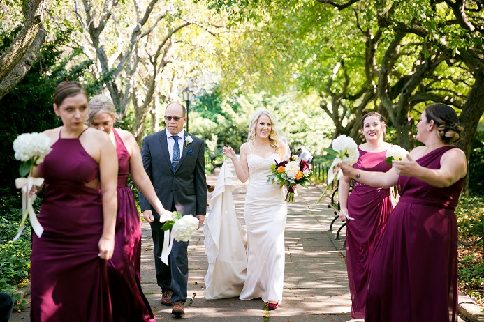 Bride walks through Conservatory Garden with Bridesmaids