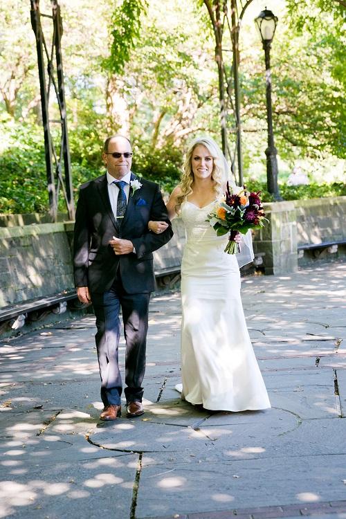 Bride walks down aisle with dad at Wisteria Pergola