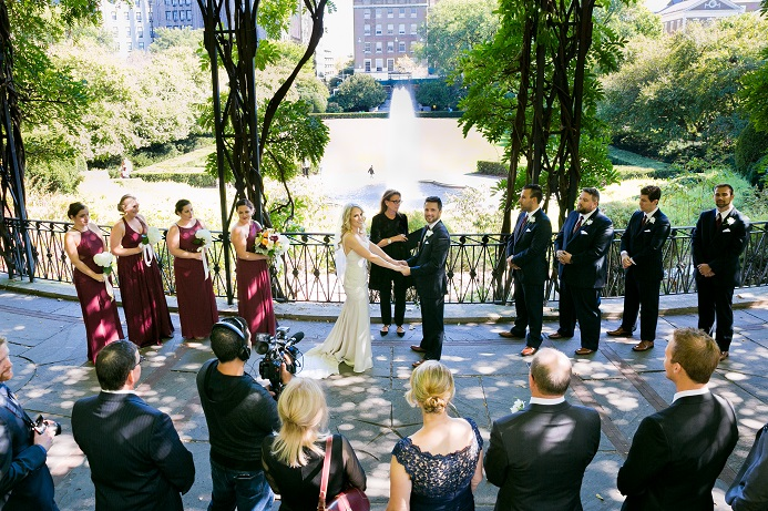 Couple getting married under the Wisteria Pergola in Central Park