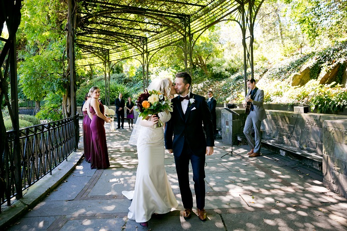 Bride and groom recess after their fall wedding at the Conservatory Garden