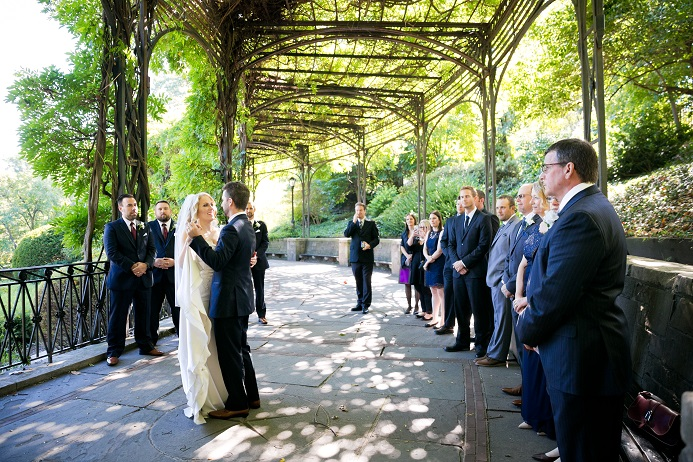 Bride and groom have their first dance under the Wisteria Pergola