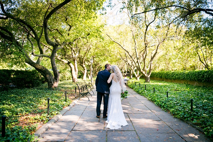 Bride and groom walk through the Conservatory Garden in NYC