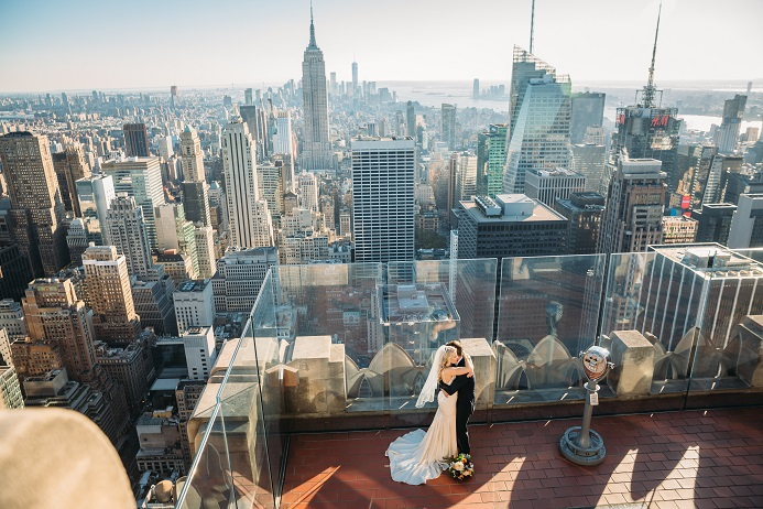bride and groom on top of the rock nyc skyline