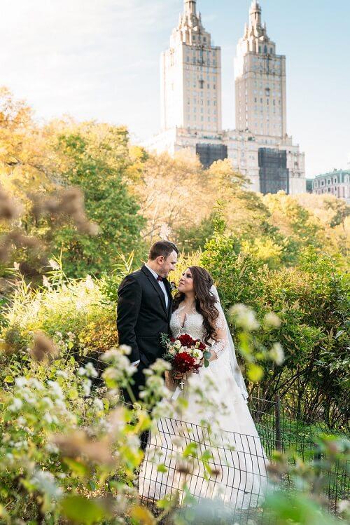 Romantic wedding portrait in Central Park along The Lake