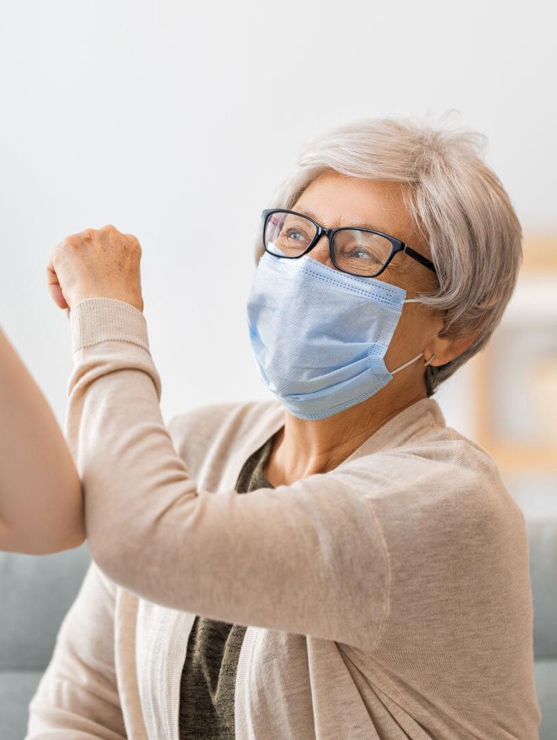 nurse elbow high fiving elderly female patient