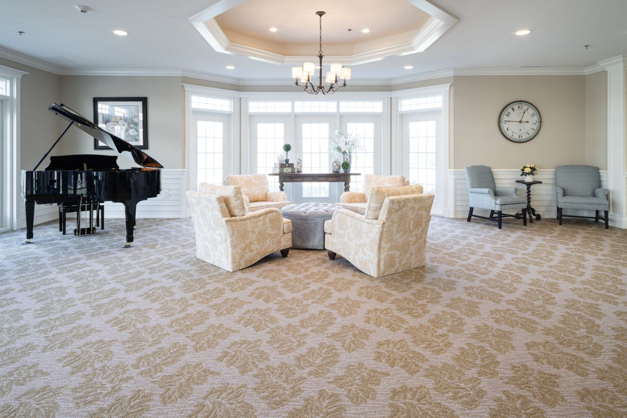 living area with seating and piano