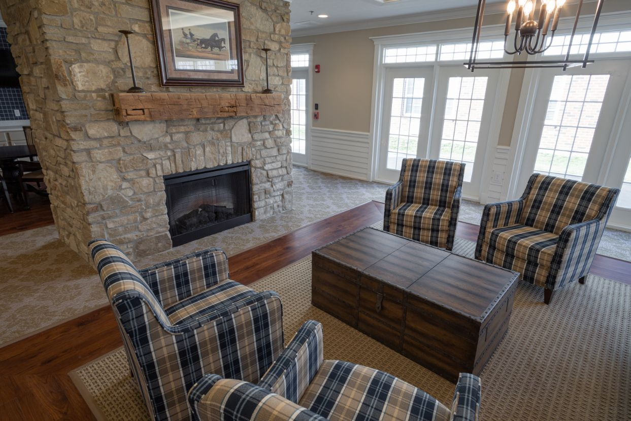 living area with fireplace and chairs