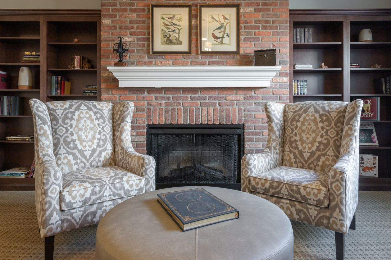 living area with fireplace and bookcases