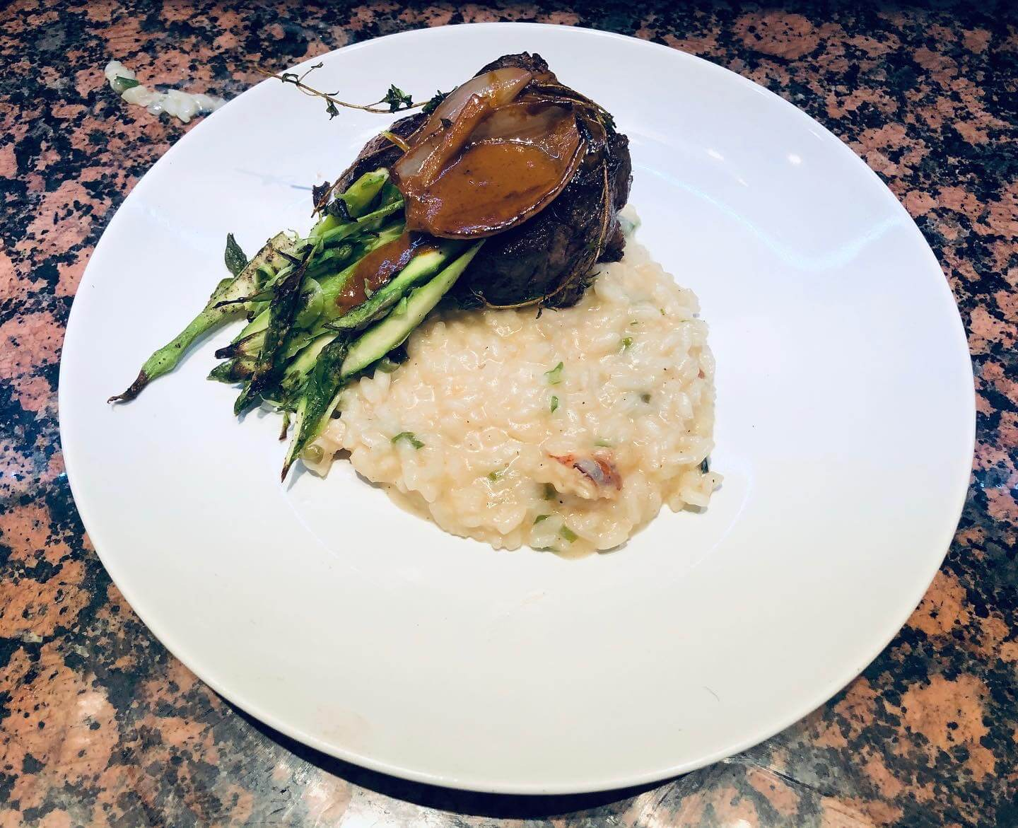 Thyme garlic filet with lobster risotto and shaved asparagus