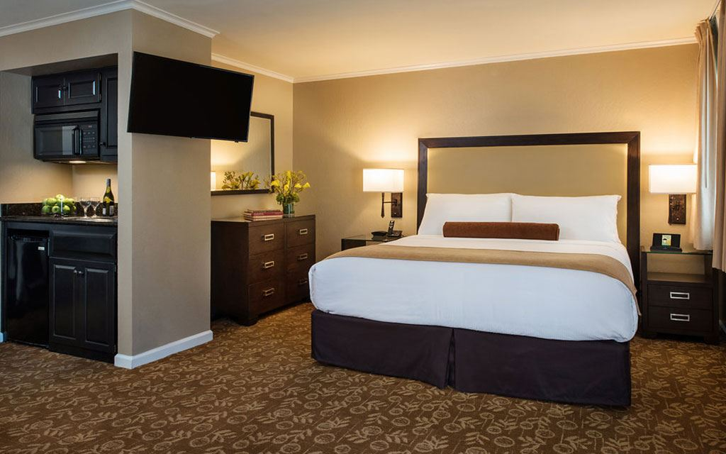 Large bed in a room with brown decorative accents