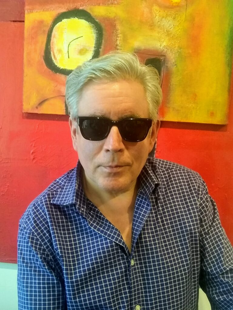 Joseph of San Francisco Optics wearing Barton Perreira sunglasses