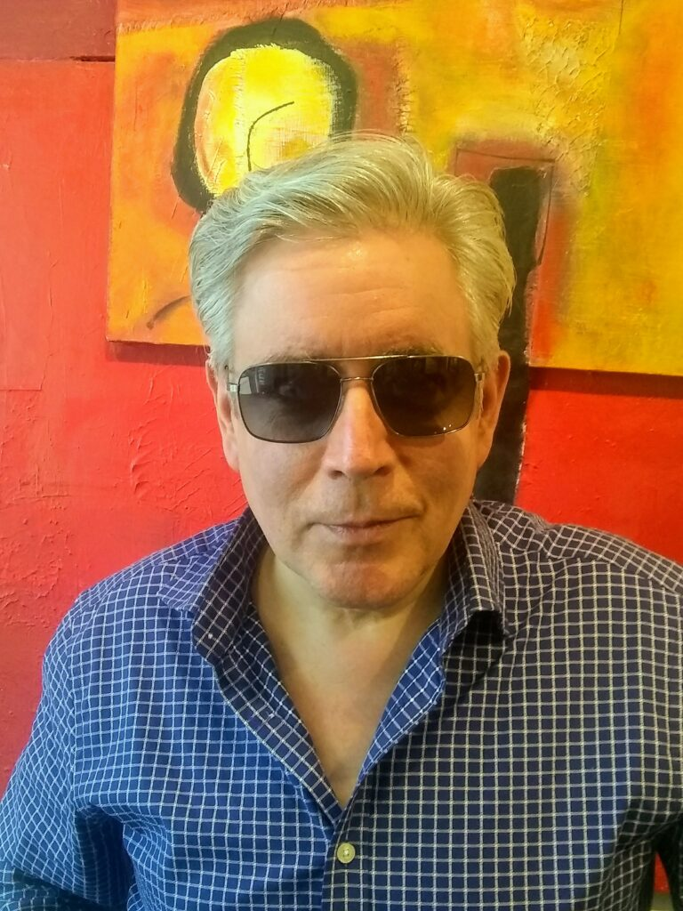 Joseph of San Francisco Optics wearing Barton Perreira sunglasses