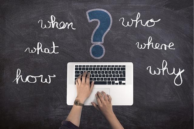 blogging critical questions on laptop