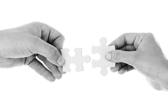 puzzle pieces together of charities we work with