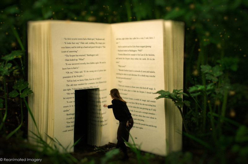 A woman walking into a book