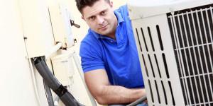 An AC Repair Technician Repairing AC