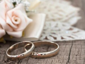 A photo of Wedding rings and flowers