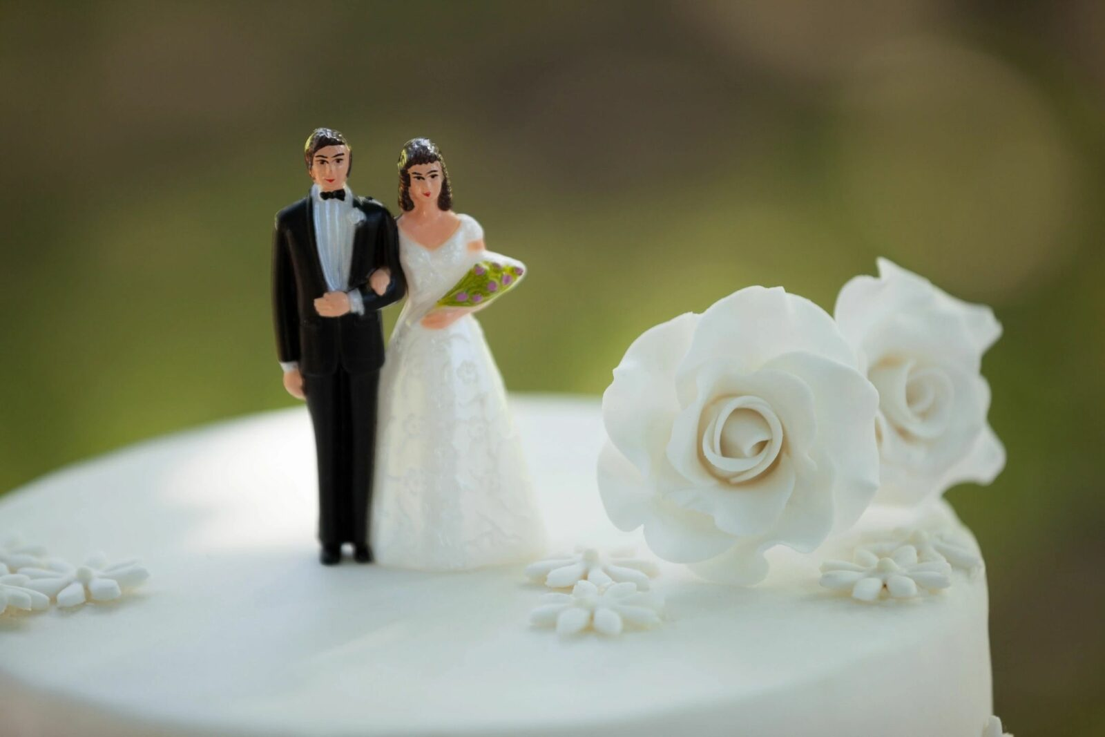 a photo of a Bride and Groom Wedding Cake Topper