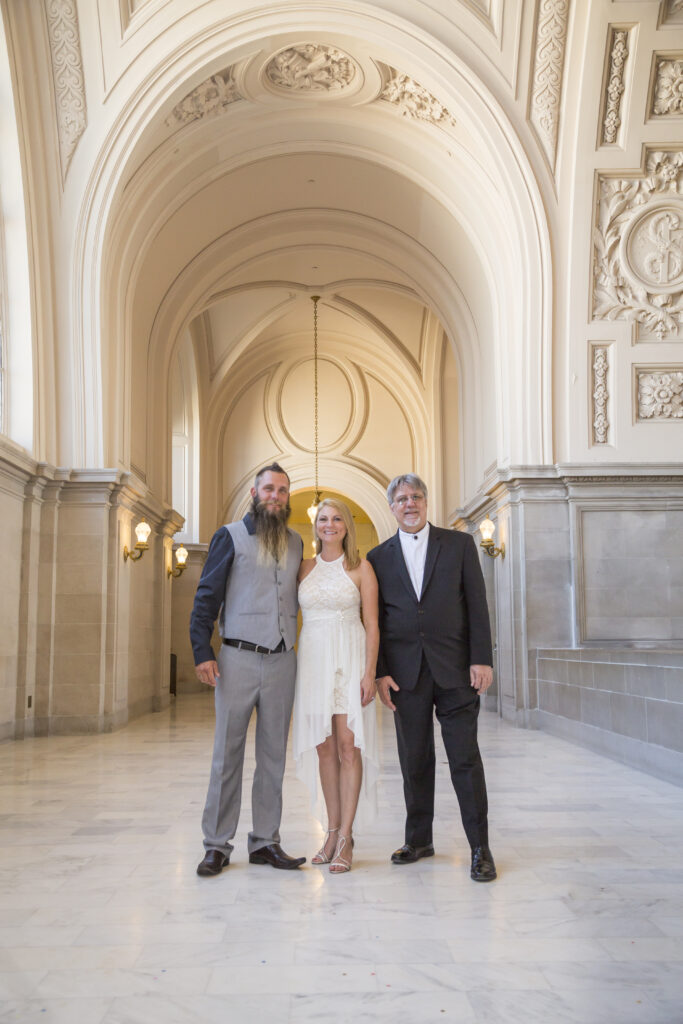 A photo of the Officiant with Couple at a San Francisco City Hall Wedding