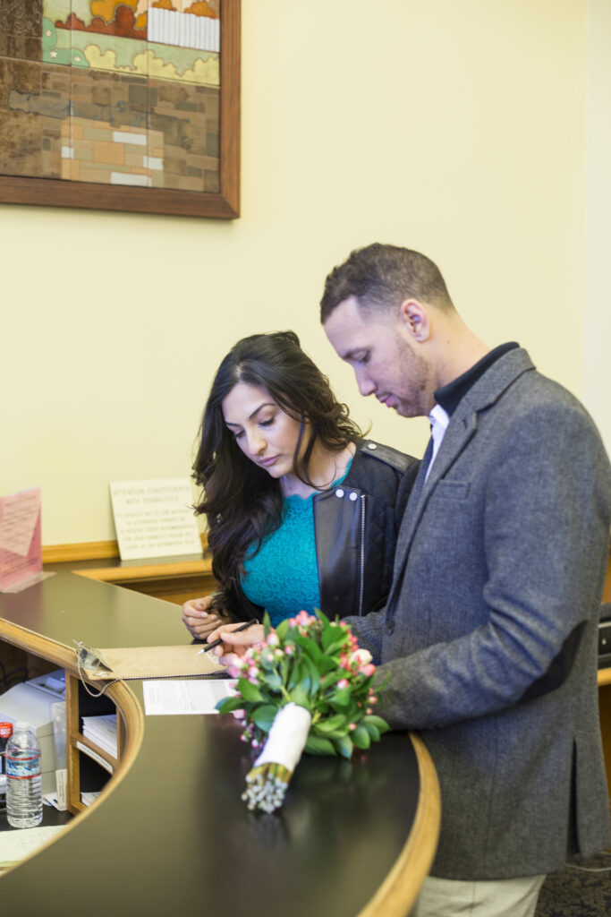 A photo of a couple applying for their marriage License
