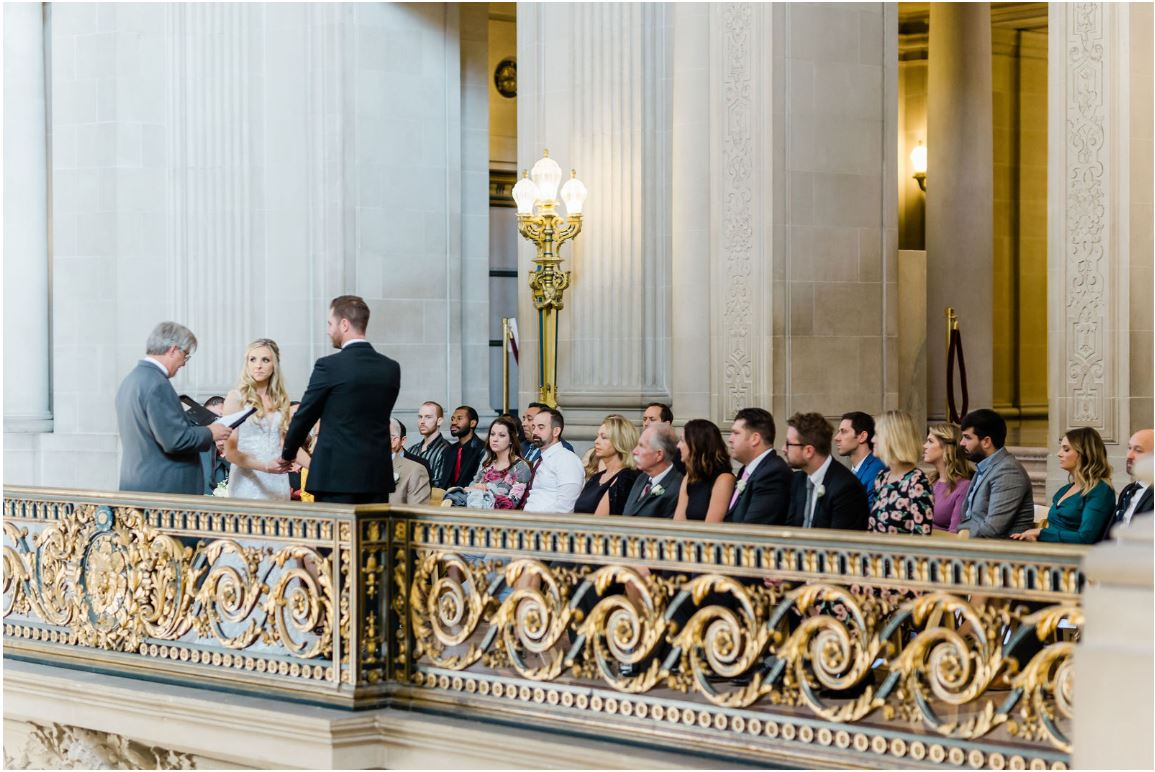 A photo of Andrew Allen officiating a wedding on the mayor's balcony San Francisco City Hall