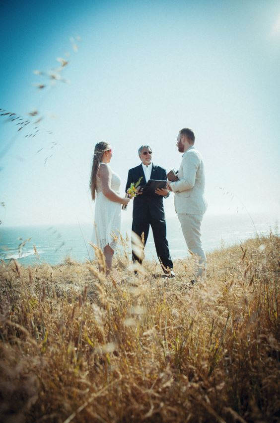 A photo of a couple having their Elopement by the Sea