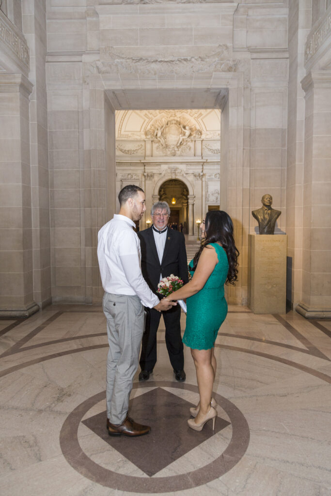 A photo of a couple and their Elopement in San Francisco City Hall