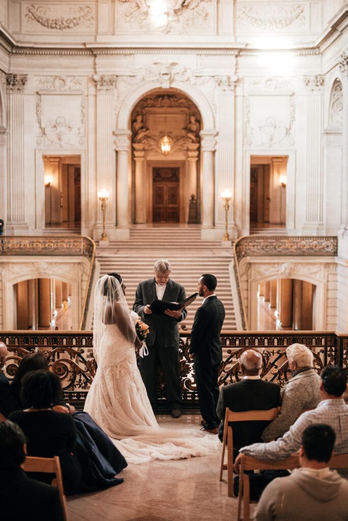 A photo of a couple's Wedding on the Mayor's Balcony at San Francisco City Hall