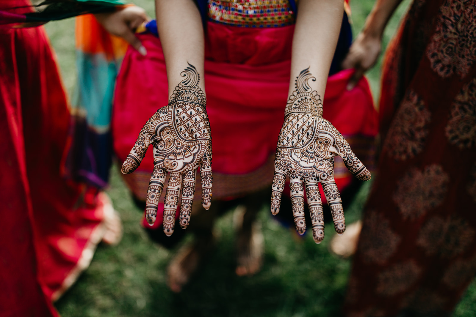 A photo of a bride shows off her Hands with Henna Mehndi for Wedding