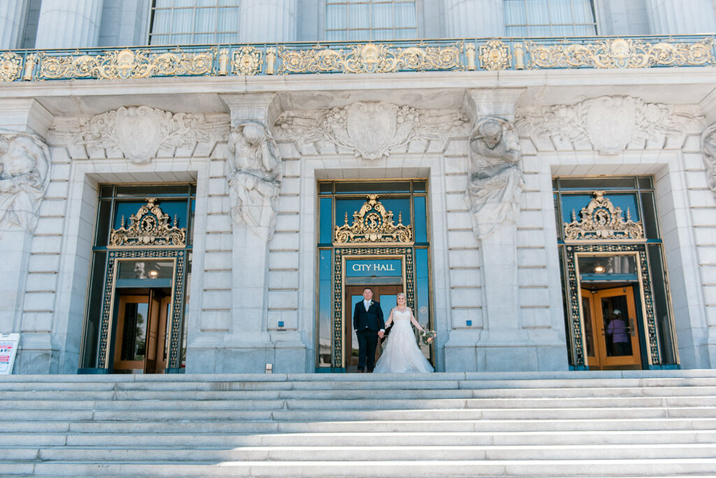 A photo of a couple Celebrating their wedding at SF City Hall