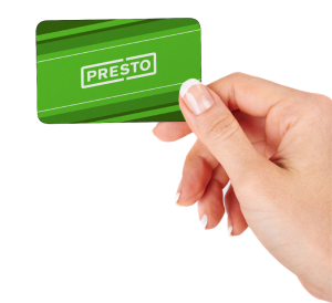 Hand holding the green Presto Card.
