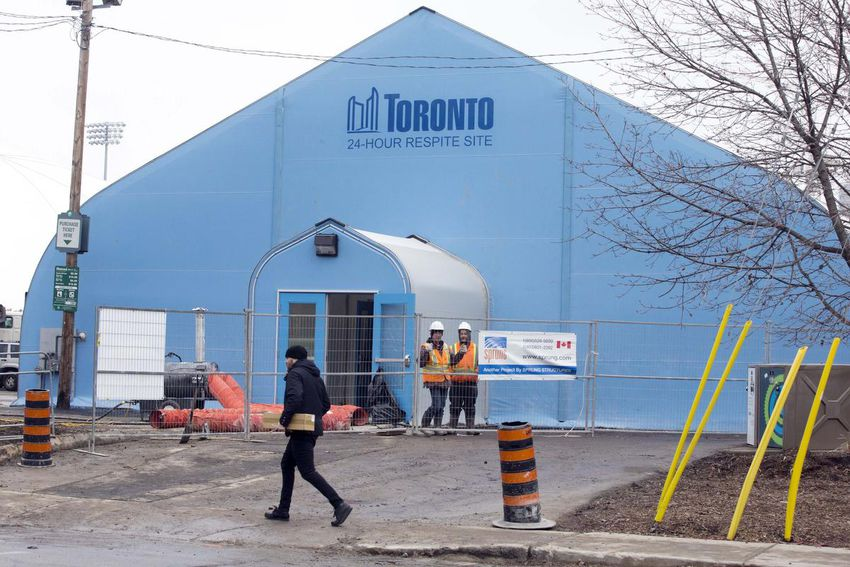 Blue respite or shelter dome with the City of Toronto logo - actually a huge tent.