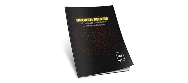 "Brown report cover with stars. Text reads ""Broken Record The Continued Criminalization of Mental Health Issues"""
