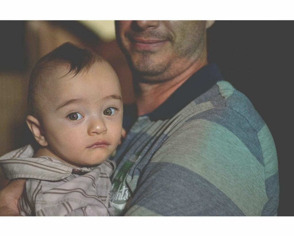 A photo of a baby and its father in Lake Forest, CA
