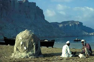 Fishermen, nets and boats Gwadar Bay, Makiran Coast of Pakistan in 1981 Picture by Christine Osborne