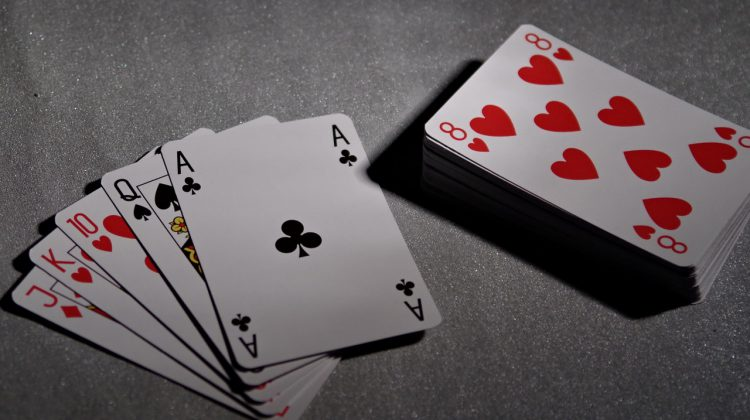 A stack and a hand of playing cards
