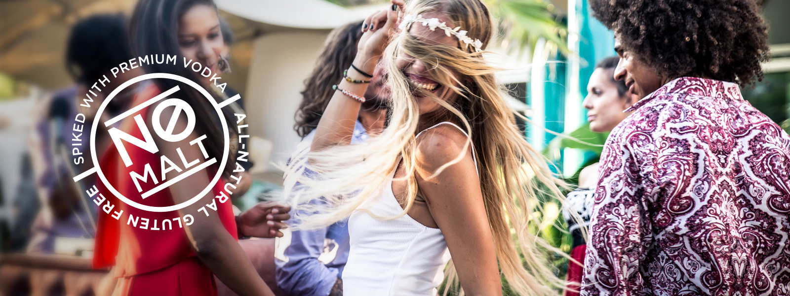 Group of friends dancing. Biza cocktails contain no malt, only premium vodka. They are all-natural and gluten free.