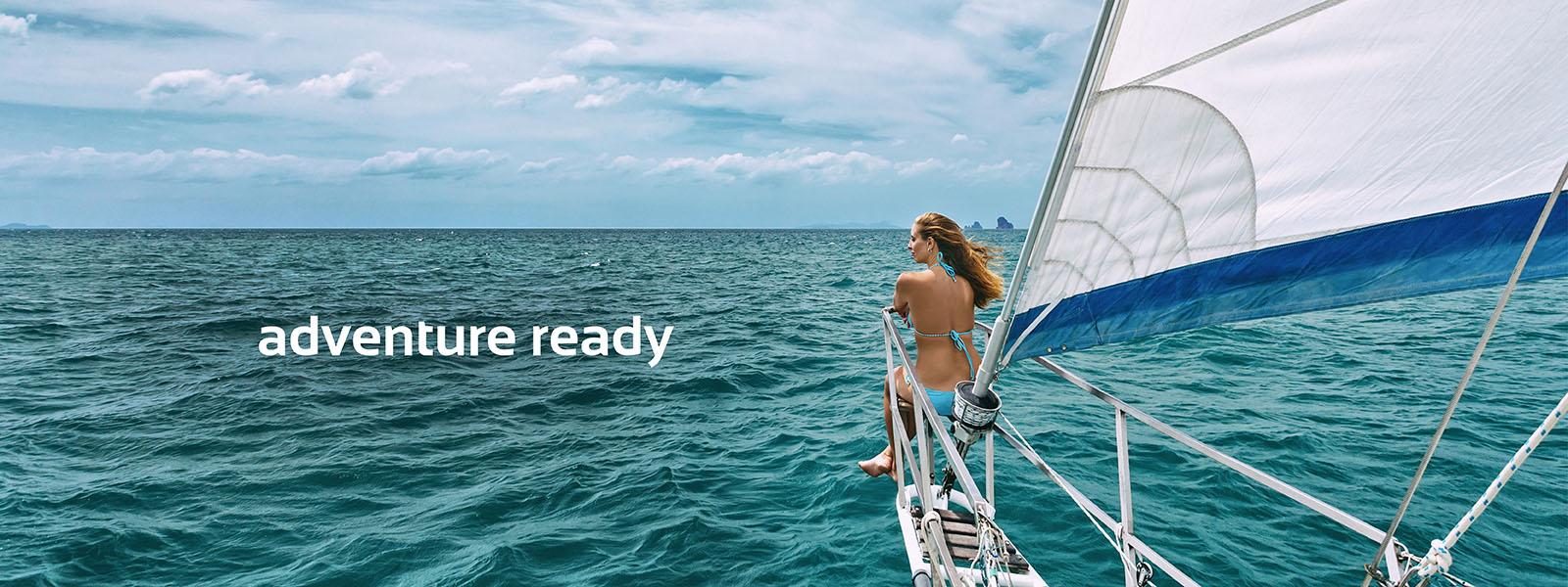 Woman in bikini on a boat in the ocean.