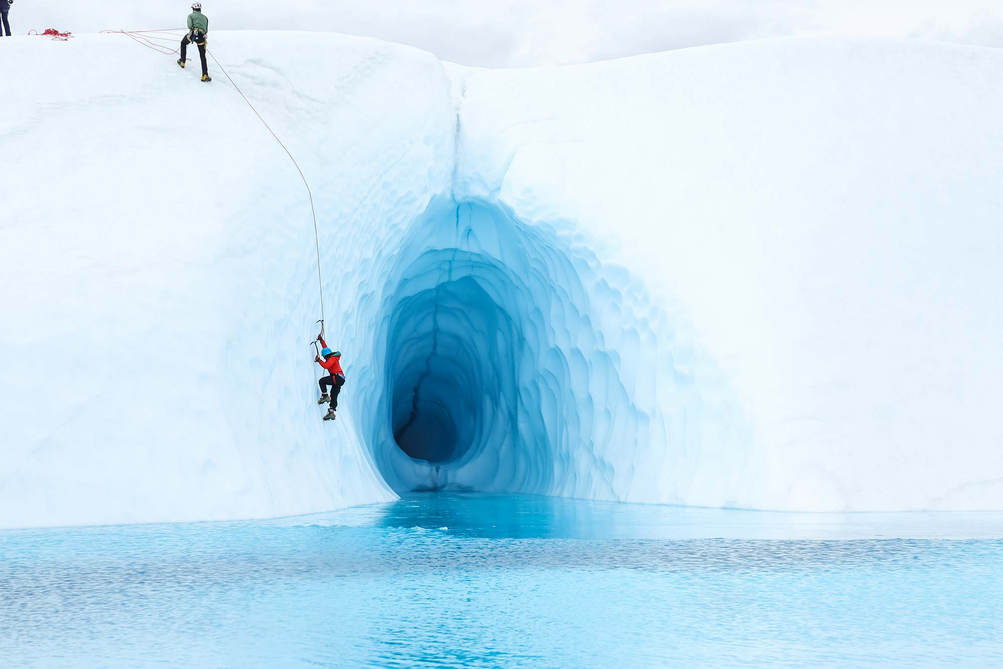 Ice Climbing over Blue Water