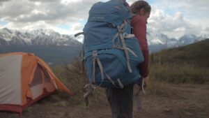 backpack tent mountains person