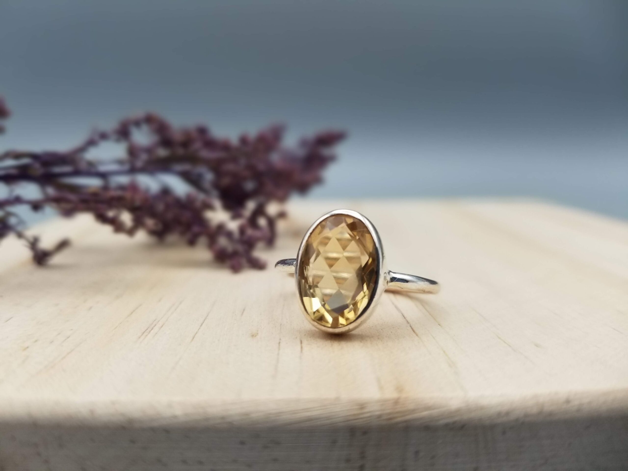 orange citrine faceted ring in a simple sterling setting