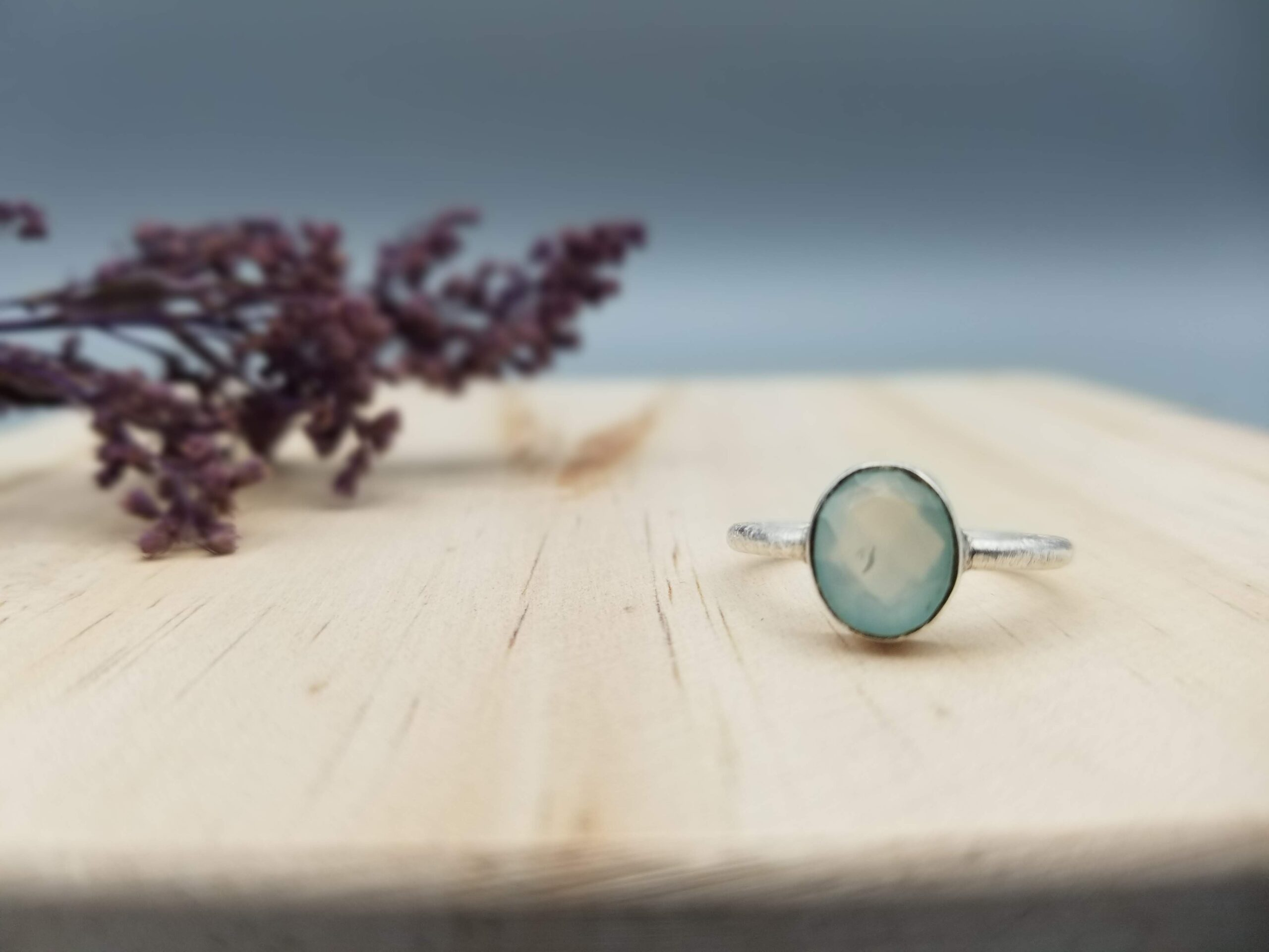 simple, modern aqua blue chalcedony ring in sterling silver setting