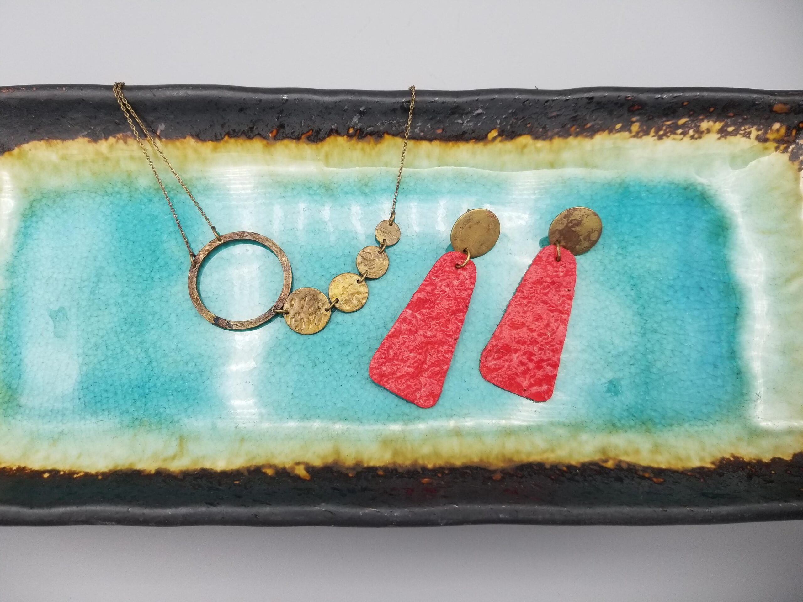 stylish combo of hand-crafted raw brass necklace and bright red handmade paper earrings