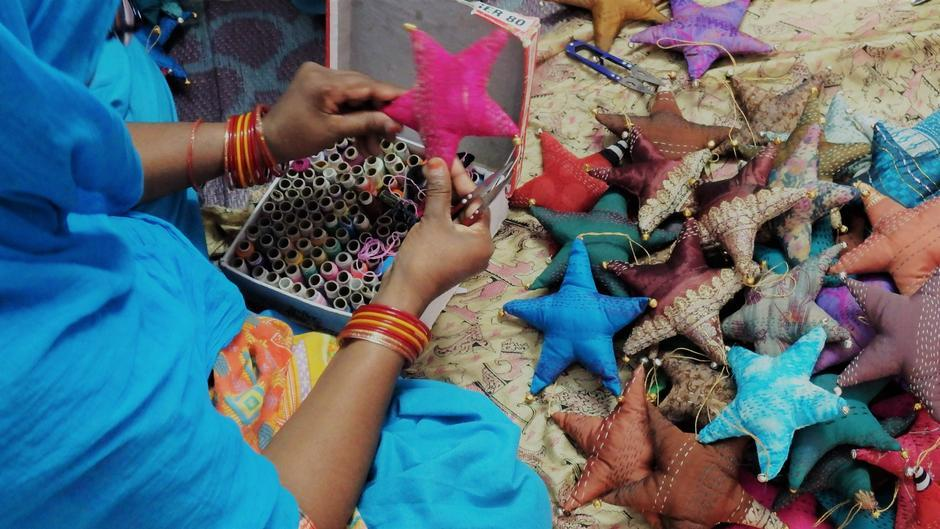 woman crafting sari stars