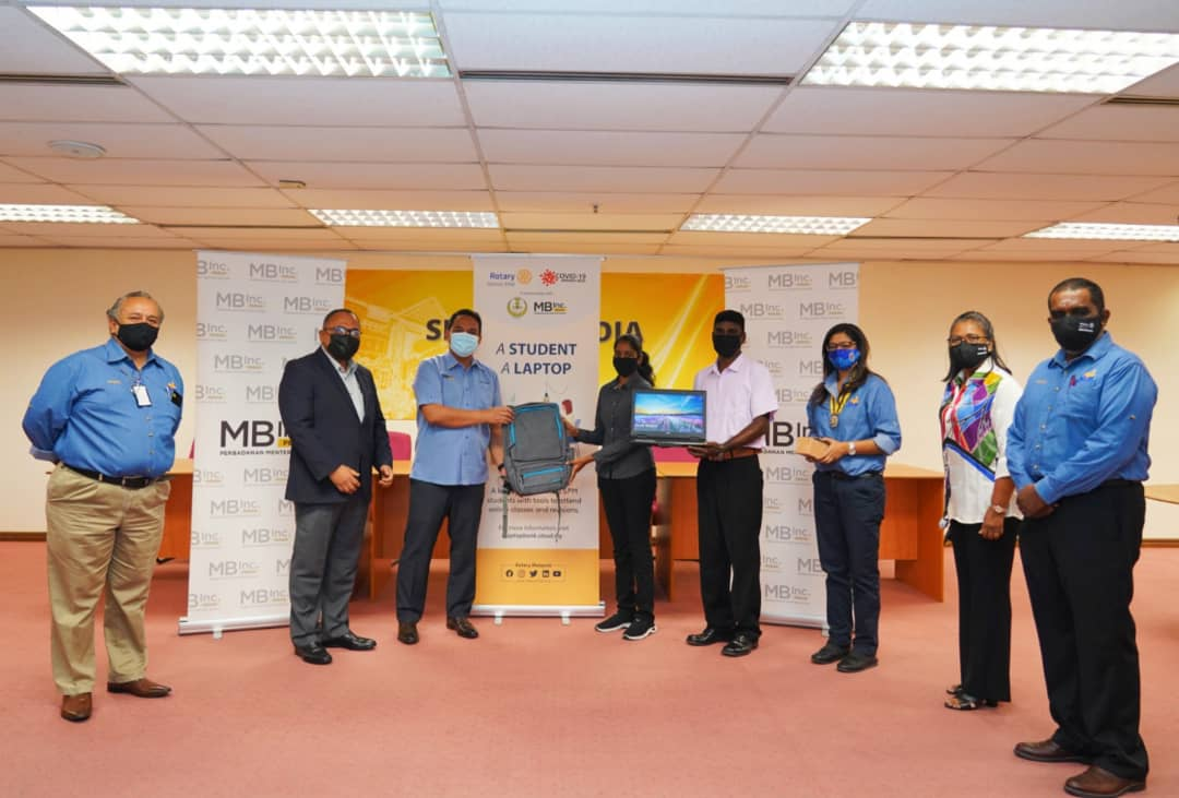 Rotary Malaysia and MB Inc Perak hand out laptops to the needy
