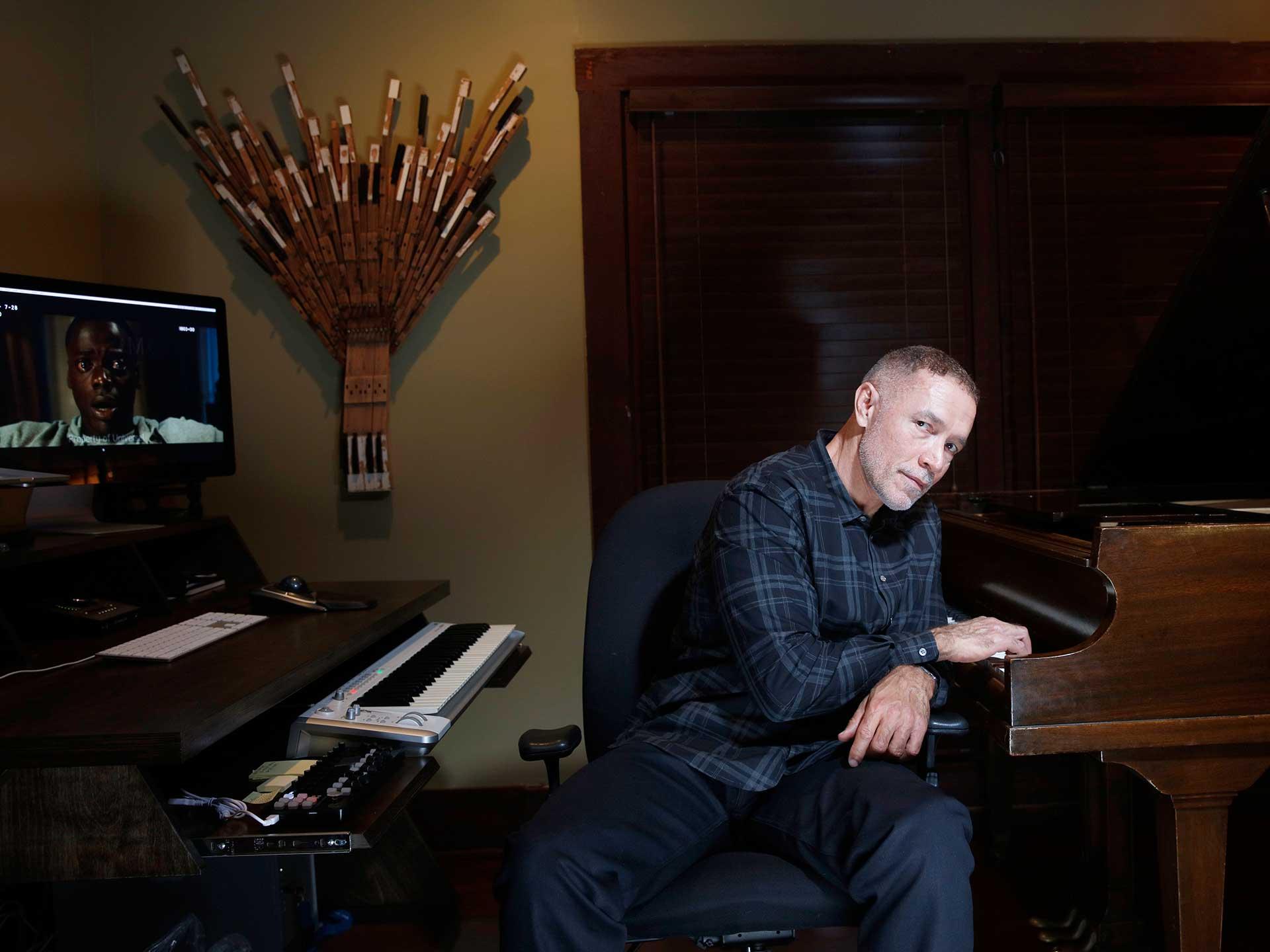 Image of Michael Abels at a piano.