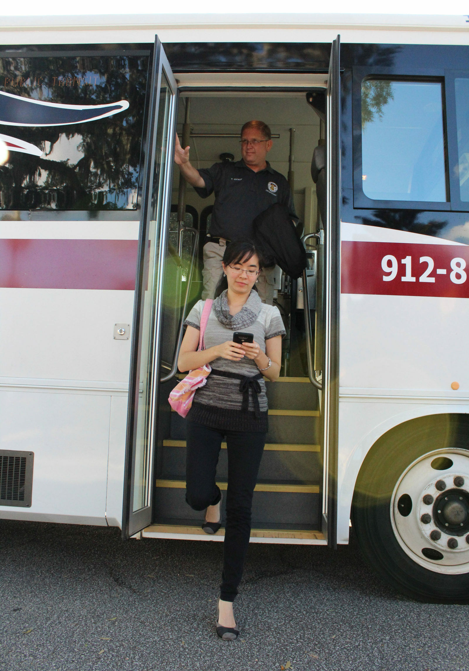 Rider getting off Liberty Transit's bus