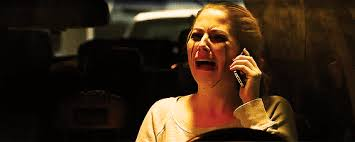 woman crying on phone because of paranormal activity