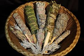 Display of sages used in smudging, blessing, cleansing