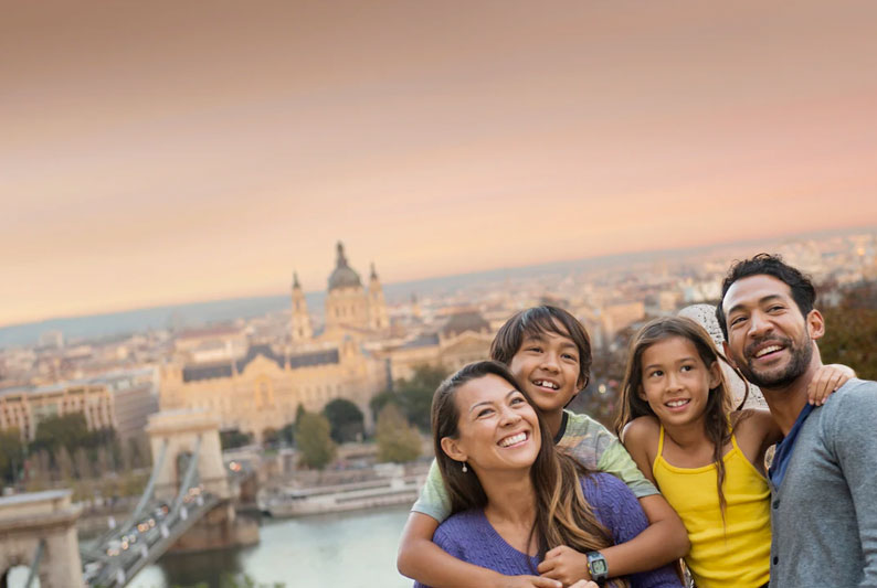 A family of 4 traveling the world via Adventures by Disney on a trip booked by Main Street Magic, LLC., a no-fee travel agency specializing in Disney vacation planning   Authorized Disney Vacation Planner